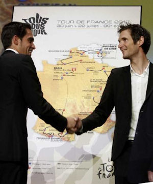 Alberto Contador greets rival Frank Schleck at Tour 2012 route presentation