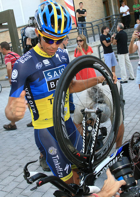 Alberto goes over his bike with a fine-toothed comb